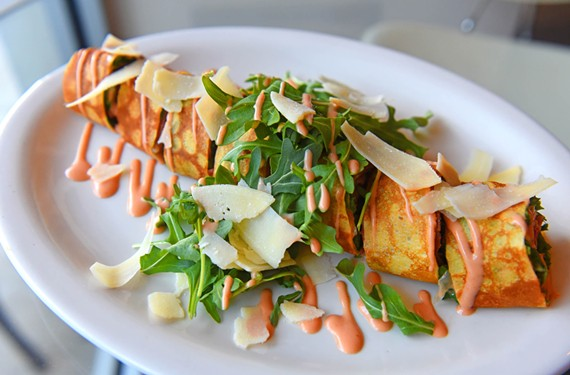Stony Point Fashion Park's Les Crepes takes the stuff-anything-into-a-crepe approach, resulting in riffs on classics such as this prosciutto and brie crepe, with Parmesan, arugula and tomato. - SCOTT ELMQUIST