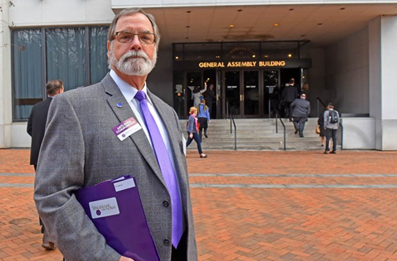 Ed Harvey, president of the advocacy group Virginians for the Arts, has talking points ready near the entrance to the General Assembly building. He hopes to reverse the state funding decrease that has occurred since 2008. - SCOTT ELMQUIST