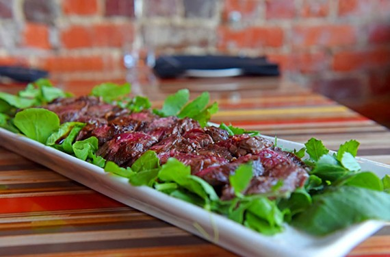 In the rare hangar steak saba, a syrupy concoction left over from winemaking and reminiscent of balsamic is paired with arugula. - SCOTT ELMQUIST