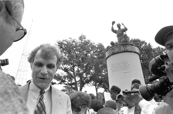 Sculptor Paul DiPasquale takes questions during the dedication of the Arthur Ashe monument in 1996. The addition of the statue was controversial. - STEPHEN SALPUKAS