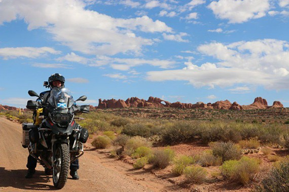 Brent Carroll rides through Arches National Park in Utah. - BRENT CARROLL
