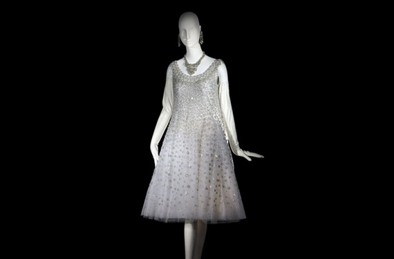 A short evening dress, elephant blanc, from spring and summer 1958 featuring a trapeze dress of white tulle embroidered with silver metallic thread and rhinestones. - ALEXANDRE GUIRKINGER