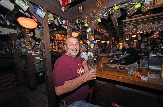 Penny Lane Pub is an oasis of Britain for expats such as Paul Marsh, as well as other dedicated soccer fans. - SCOTT ELMQUIST