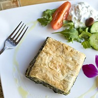 Review: A Reopened Athens Tavern in the Fan Still is Drawing Regulars
