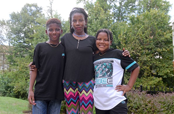 """My'Shanniece Tabron, 30, shown with her children Zyki Tabron, 13, and Dinz Tabron, 10, calls HOME """"a turning point"""" in helping her settle into a stable apartment complex with access to a good elementary school. - SCOTT ELMQUIST"""