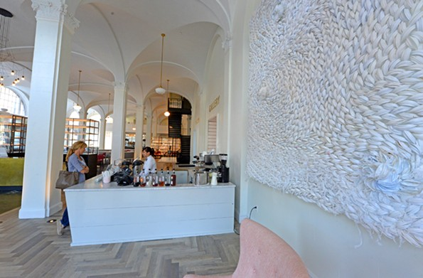 Quirk Hotel's coffee bar has also embraced the crisp white color scheme. - SCOTT ELMQUIST