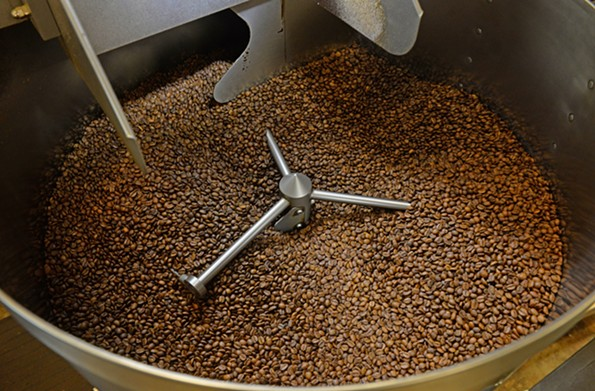 Small-farm beans go through the roasting process at Blanchard's Coffee Roasting Co. - SCOTT ELMQUIST
