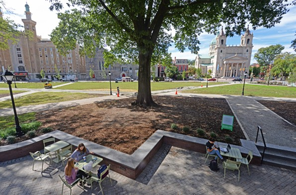 Newly installed retaining walls accentuate slight grade changes in the park and provide additional seating. - SCOTT ELMQUIST