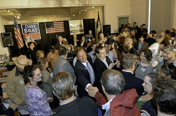 Republican congressional candidate Dave Brat works the room following a campaign appearance in Ashland in 2014, prior to defeating Eric Cantor. - SCOTT ELMQUIST