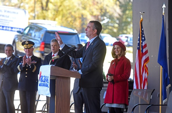Earlier in nearby Dogwood Dell,  Gov. Ralph S. Northam addresses those gathered for Veterans' Day as first lady Pamela Northam looks on. - SCOTT ELMQUIST