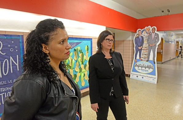 Councilwomen Kim Gray and Kristen Nye Larson at Carver Elementary School in front of a life-sized cutout of School Superintendent Jason Kamras and Mayor Levar Stoney. - SCOTT ELMQUIST