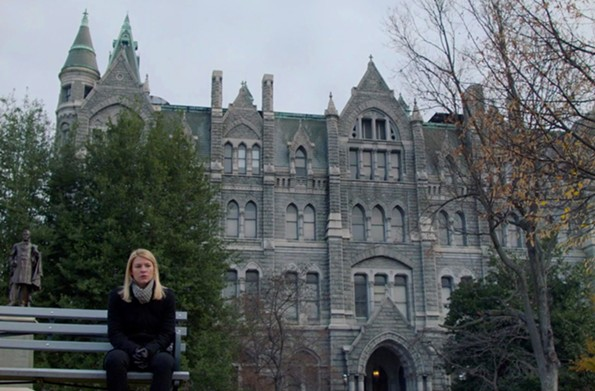 Actress Claire Danes sits with a backdrop of Old City Hall at 1001 E. Broad St. in all its Victorian gothic glory.