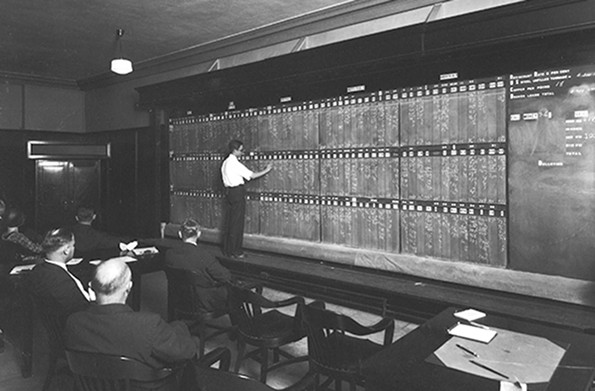 A board boy chalked quotes at the Jefferson Hotel boardroom of Shoaf & Shoaf, an investment firm, in the late 1920s.