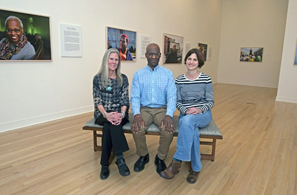 Curator and VCU associate professor Ashley Kistler, photojournalist Brian Palmer and University of Richmond professor and oral historian Laura Crowder stand in the Joel and Lila Harnett Museum of Art at the University of Richmond's Modlin Center for the Arts. - SCOTT ELMQUIST