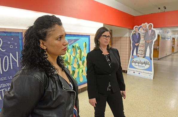 Councilwomen Kim Gray and Kristen NyeLarson at Carver Elementary School stand in front of a life-sized cutout of School Superintendent Jason Kamras and Mayor Levar Stoney. - SCOTT ELMQUIST