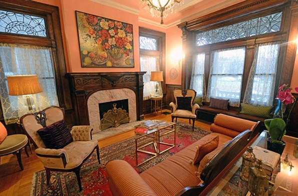 Paul and Julie Weissend's Monument Avenue home is rich in history, and has a masculine structure. The couple has worked to balance that masculinity with a degree of femininity in its interior design, hence the bright colors. - SCOTT ELMQUIST