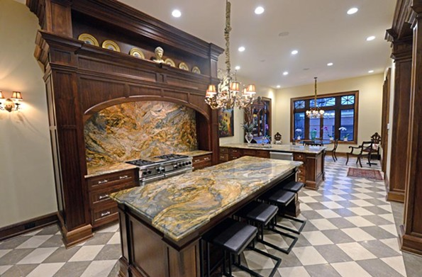 The 2710 Monument Ave. kitchen has a backsplash and countertops of large slabs of quartzite, a gorgeous naturally occurring stone that brings flair to the kitchen and an earthy appeal. - SCOTT ELMQUIST