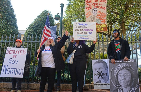 Protesters outside the Executive Mansion on Monday, Feb. 4, include activists on several issues calling for Northam to resign. - SCOTT ELMQUIST