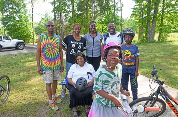 Now that Raediance Ragland, front right, can ride a bike without training wheels, she and her family prepare for their first group outing on the Capital Trail. - SCOTT ELMQUIST