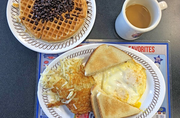 A chocolate-chip waffle provides a sweet counterpoint to a plate of eggs, hash browns and toast at Waffle House. - SCOTT ELMQUIST