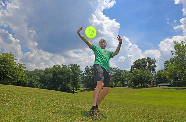 A lead organizer and coach, Richmonder Jack Cooksey does a maneuver in Forest Hill Park. A world record holder, Cooksey has been playing and promoting the sport since the late 1970s in Richmond. - SCOTT ELMQUIST