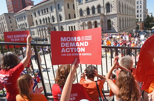 Members of Moms Demand Action protest gun violence on Tuesday, July 9, the day of the special session on new gun legislation that Republicans pushed until after the November election. - SCOTT ELMQUIST