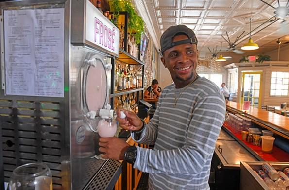 Bartender Shaun Aaron pours a froséat Beauvine Burger Concept. - SCOTT ELMQUIST