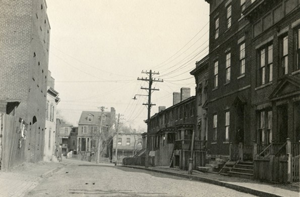 "A view looking north from Ross Street of Mayo Street, no longer in existence, which used to house Richmond's legalized sin district — once called ""the best in the United States"" by the U.S. Department of Justice. This red light district ended in 1915 after roughly a decade. - COOK COLLECTION, THE VALENTINE"