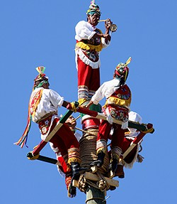 The Tezcatlipoca Voladores spun down from atop a 30-meter pole in 2015. - RICHMOND FOLK FESTIVAL
