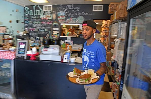 Brandon James carries out an order to a customer. - SCOTT ELMQUIST
