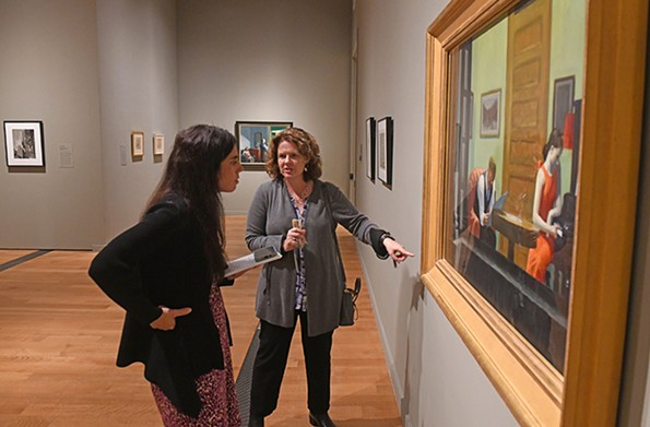 "Amanda Dalla Villa Adams looks at ""Room in New York"" with Sarah Powers, a curatorial research specialist. - SCOTT ELMQUIST"