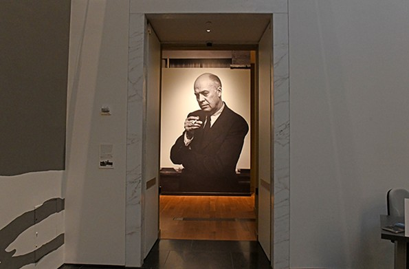 A black-and-white image of Edward Hopper greets visitors near the entrance to the exhibit, which runs through Feb. 23. - SCOTT ELMQUIST