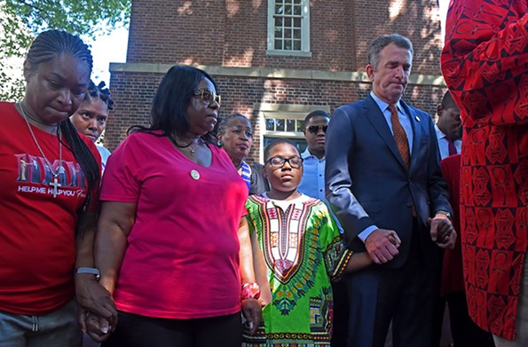 The governor lay low in the months after the scandal, but took a more prominent role at a gun-violence rally at the State Capitol in July after a shooting at a Virginia Beach government building. - SCOTT ELMQUIST/FILE