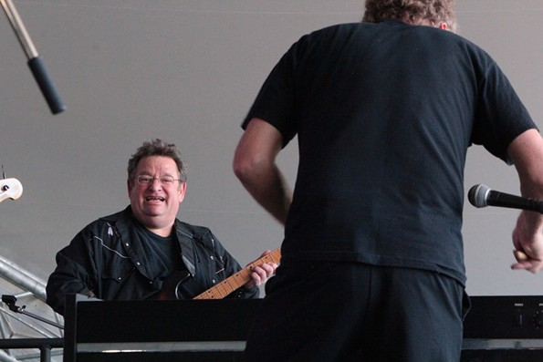 A shot of a thrilled Jim Wark, filling in last minute with rockabilly artist Jason D. Williams at the Richmond Folk Festival in 2016. - BRENT BALDWIN