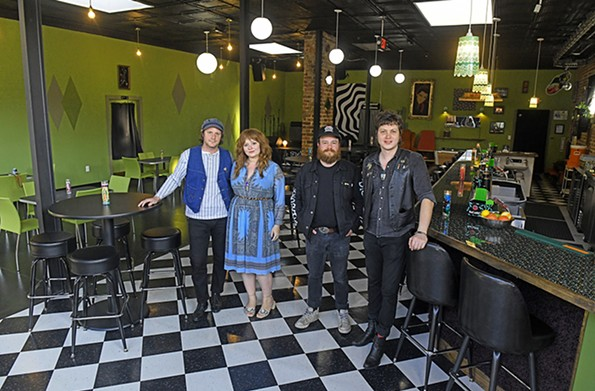 Fuzzy Cactus co-owners Michael Cipollone and his wife, Patty Conway, Drew Schlegel and bar manager Paul Kirk stand inside their new restaurant and venue with the '70s basement bar vibe at 221 W. Brookland Park Blvd. - SCOTT ELMQUIST/FILE