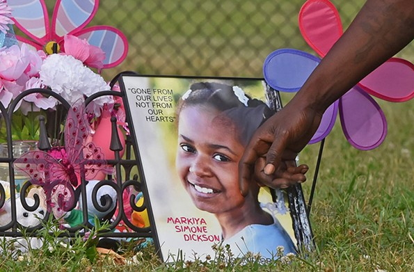 A memorial for Markiya Simone Dickson in Carter Jones Park. Markiya was shot and killed at the park during a cookout on Memorial Day weekend. About 200 people gathered for a vigil in Markiya's honor. - SCOTT ELMQUIST