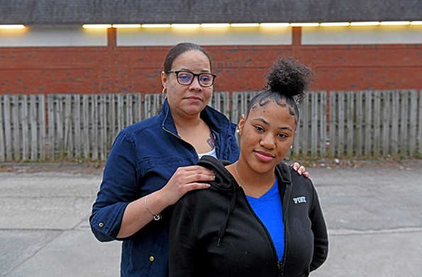 Briana Austin can recall having recurring nightmares following the shooting of her mother, Star Myles, pictured behind her. - SCOTT ELMQUIST
