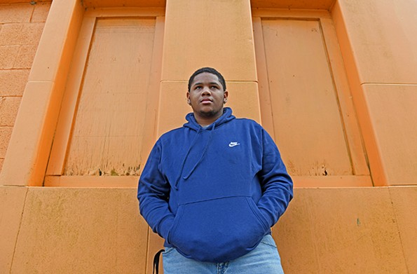 """TaequanSmith, 18, had to learn how to walk again after he was shot in both thighs and his left calf in the Hillside Court neighborhood. He didn't catch a glimpse of the shooter, who wasn't apprehended. A friend who was with him only remembers seeing a green beam of light from behind buildings. Smith says the incident has left him constantly looking over his shoulder.  """"I was a very outgoing person. I was a person who would always want to go to parties,"""" he says. He adds that his fear is not about the crowd, """"but who's in the crowd."""" The shooting made him look at life differently and """"take it one day at a time."""" Smith says he excels in math and plans to study physical therapy or accounting. - SCOTT ELMQUIST"""