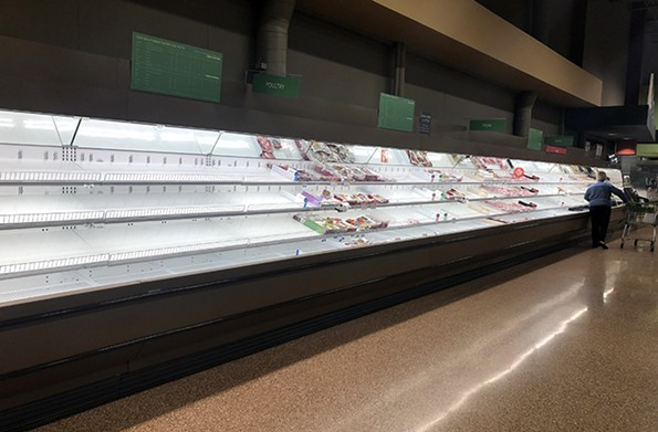 Meat sections were particularly empty in grocery stores last week, such as this one at a Publix. - SCOTT ELMQUIST