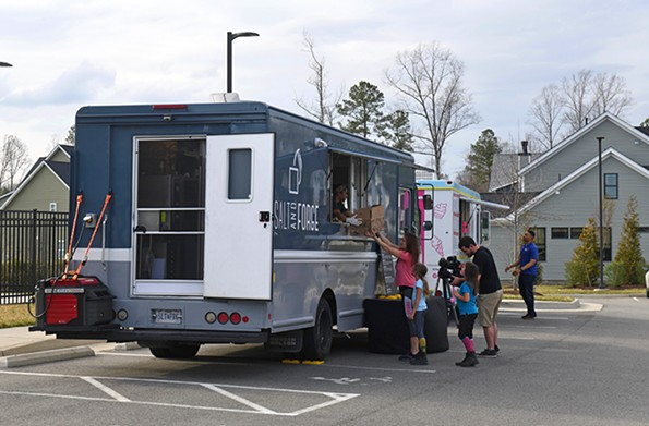 Salt and Forge and JiJi Frozen Custard food trucks created Dining Without the Restaurant to bring restaurant-quality meals to the community. They're shown here on March 19 at the RounTrey community in Midlothian. - SCOTT ELMQUIST