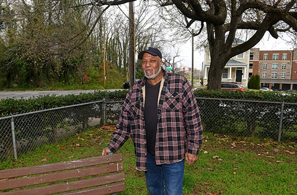 Richmond native and retiree Larry Lambert regularly surveys West 19th Street and the downtown skyline from the grounds of his home at Stonewall Place. - SCOTT ELMQUIST