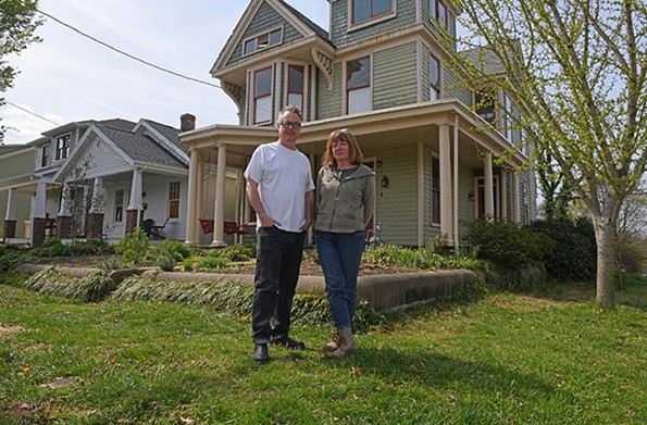 Greg and Sherri Johnson in front of the distinctive house they have restored in the 500 block of West 19th Street. - SCOTT ELMQUIST