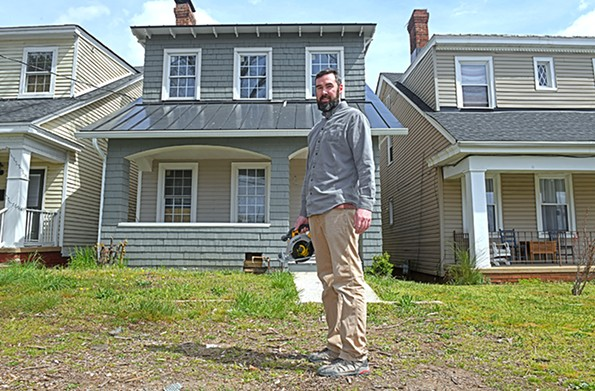 Contractor Todd Matthew takes advantage of a day off to work on a personal house restoration on West 19th Street. - SCOTT ELMQUIST