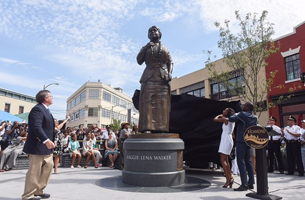 Sculptor Toby Mendez, left, watches Liza Mickens, the great-great-granddaughter of Maggie Walker, and Mayor Levar Stoney pull a cover off the new statue to Walker in 2017. - SCOTT ELMQUIST/FILE