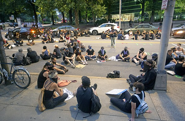 The protesters broke out into discussion groups behind City Hall on Marshall Street, which they renamed Reclamation Square. - SCOTT ELMQUIST