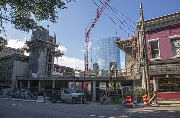 Amid mostly empty office buildings downtown, construction continues at Goodstein Development Corp.'s Centennial Terrace apartments, a 53-unit structure at 523 E. Main St. The new Dominion Energy high-rise is in the distance. - SCOTT ELMQUIST