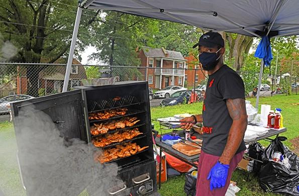 Smoking Ice chef Earl Lee works the meat smoker. - SCOTT ELMQUIST