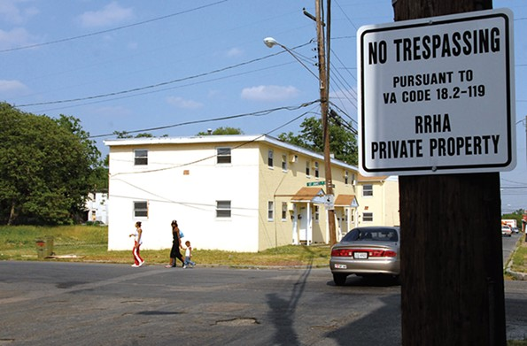Gilpin Court public housing was featured in a recent New York Times article explaining how racist federal policies from the 1930s led to it becoming one of the hottest places in town with few trees and plenty of heat-trapping pavement. - SCOTT ELMQUIST/FILE