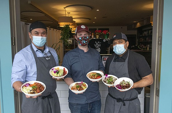 Mike Ledesma, Kevin Tate and Sergio Gomez-Ramos serve travel-friendly meals at their pandemic-proof restaurant, InstaBowl. - SCOTT ELMQUIST
