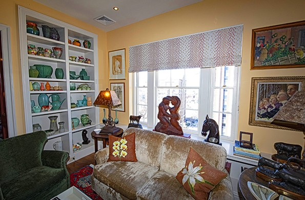 American pottery and ceramics displayed in the den include works by the Catalina, Teco and Weller studios. The lamp bases are fashioned from wrought iron remnants and crowned by mica shades. - SCOTT ELMQUIST
